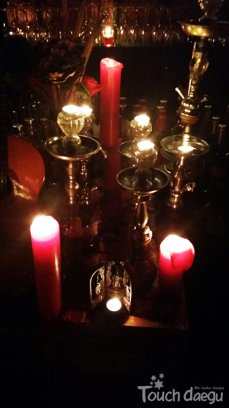 Beautiful candles on the wine table