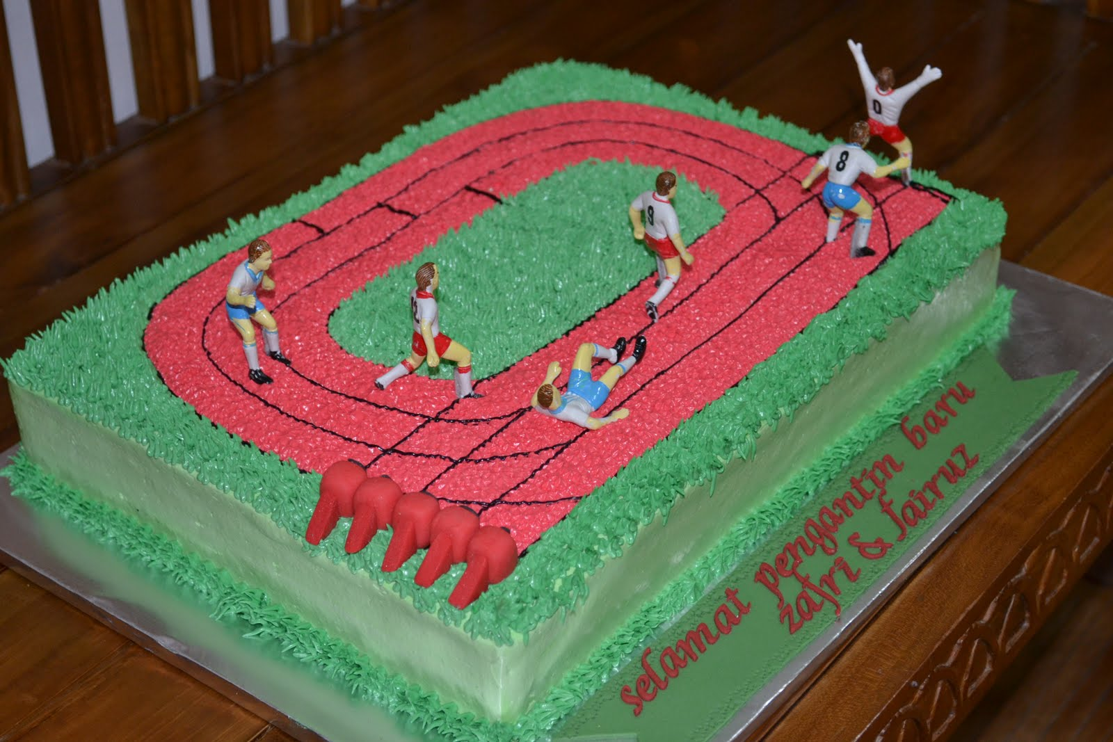 Track and Field Cake Three Brothers Bakery