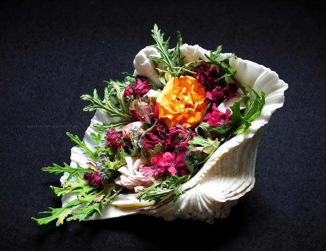 Potpourri with rosebuds, mint flowers and scented pelargonium leaves and flowers