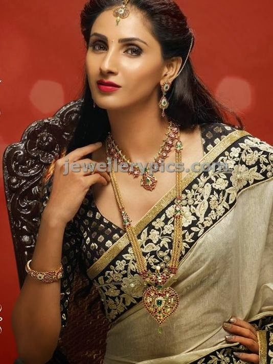 jcs jewellers advertisement model wearing long chain with heart shaped ruby pendent