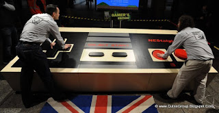 The world's largest videogame controller, created by British engineering student Ben Allen. The fully functional joypad is 30 times the size of a standard NES controller, measuring 12ft x 5ft 3in x 1ft 8in. The controller celebrates the launch of the new Guinness World Records 2012 Gamer's Edition book.