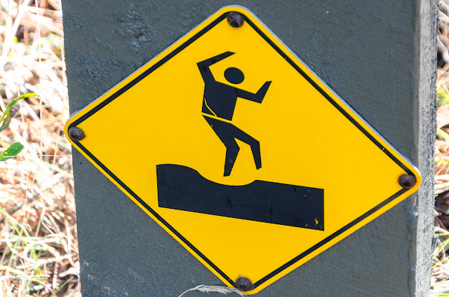 man dancing on danger sign