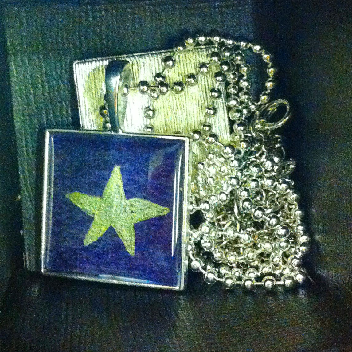 a star pendant in a box