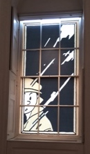 Cartoon pic of Tintin covering window