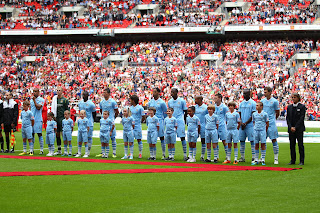 Manchester City Player Escorts Charity Shield 2011