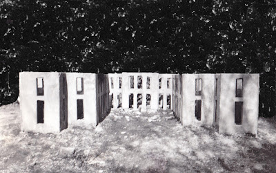 b/w image of raw concrete walls of 1/48 scale of Versailles