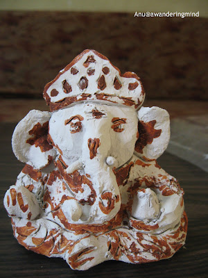 Lord Ganesha Clay idol done using red brick powder of geru or chemman, an Eco friendly Ganpati in A Mumbai household during the Ganesh Chaturthi Celebrations