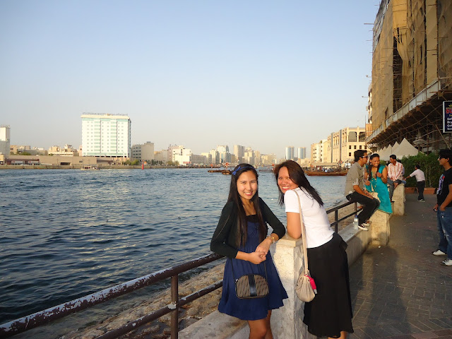 Lady and a friend before the Abra Ride at Dubai Creek