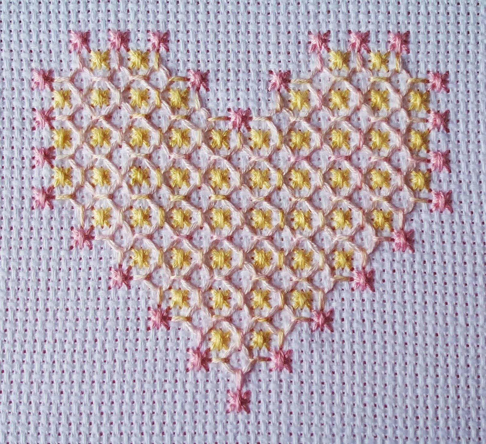 eglantine stitchery  chicken scratch heart  on aida