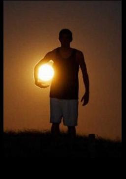 Holding sun optical illusion