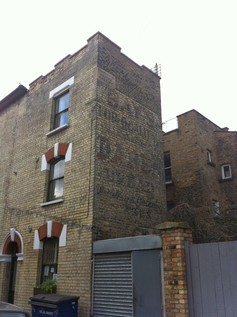 Ghost sign in Vauxhall Grove, London