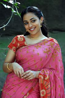 Nitya Menon movies tills in a lovely pink saree Spicy Nithya Menon