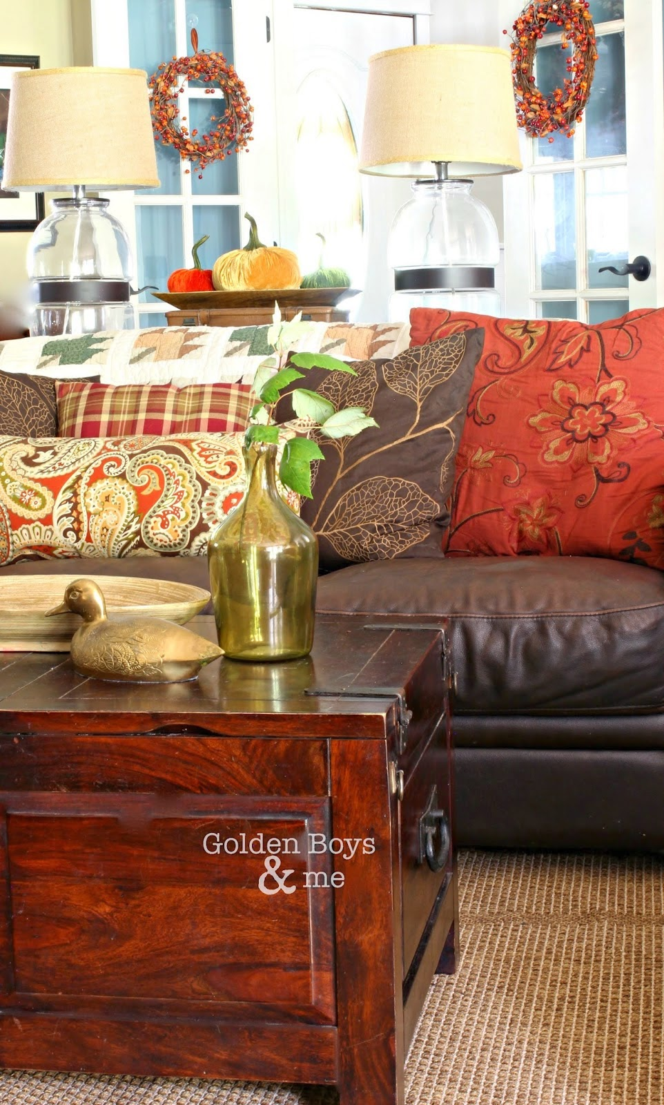 Brown leather sofa in family room with fall decor-www.goldenboyandme.com