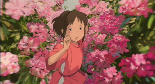 Chihiro running through a garden in Spirited Away 2001 animatedfilmreviews.filminspector.com