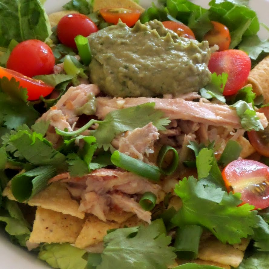 Tequila Lime Chicken Taco Salad:  Left over rotisserie chicken,  shredded,  marinated in tequila and lime juice topping green lettuce and tortilla chips.