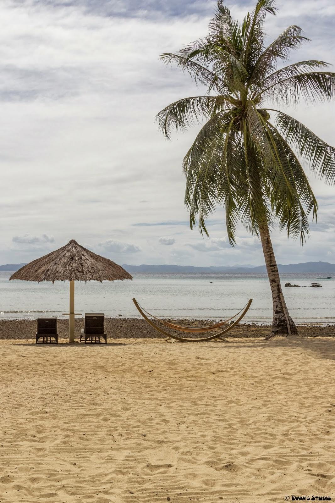 The relaxing beach view from Apulit Island Resort in the Philippines.