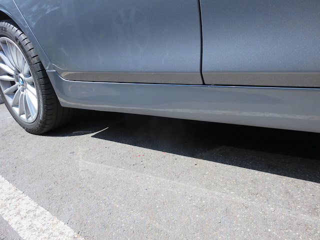 BMW after deep paint scratches repaired at Almost Everything Auto Body