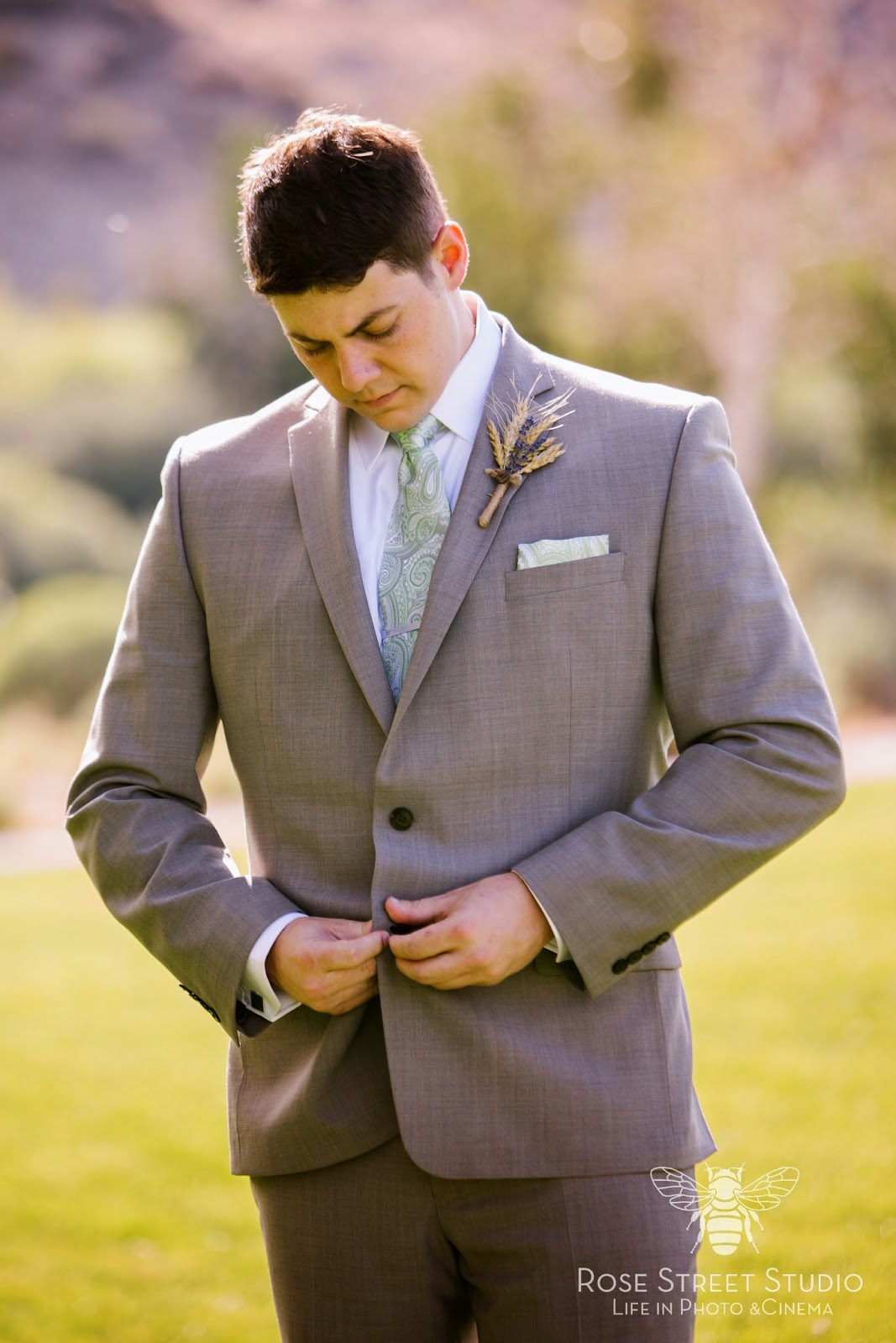 Groom in grey with rustic wheat boutonniere l Rose Street Studio l Take the Cake Event Planning