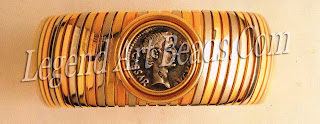 """A """"gas pipe"""" clip bracelet in three colours, set with a rare Roman silver coin of the Emperor Augustus (43 nc-I4 A D)."""
