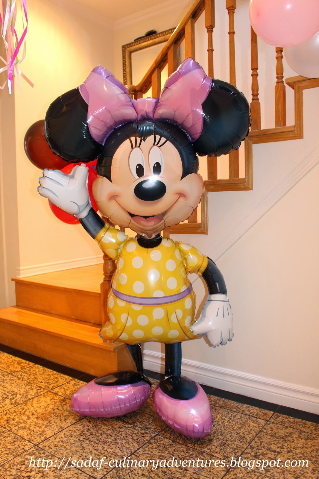 Giant helium filled Gliding MInnie Mouse from Party City