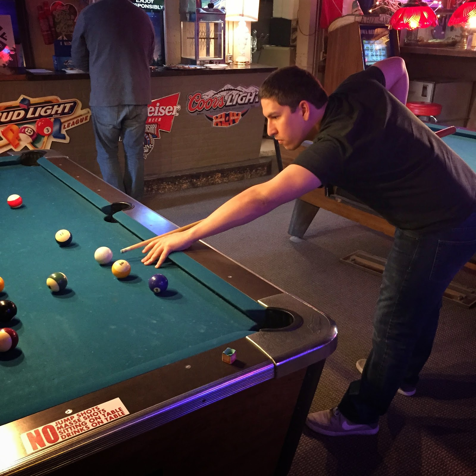 playing pool at stevie c's dive bar grimes