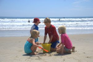 Kids on Family Beach Vacation 2 - Family at the beach. Stock Photo credit: hortongrou