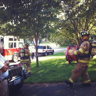 firemen carrying fans