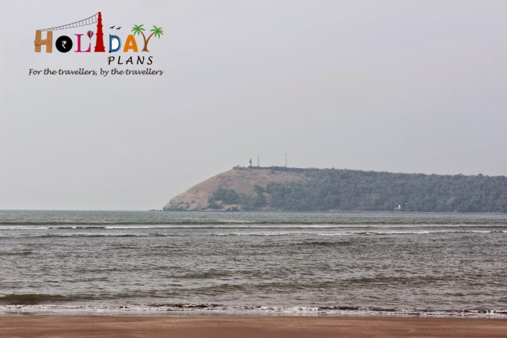 Light house in distance from Bhatye Beach