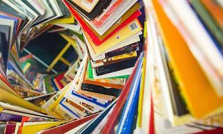 books spiraling towards ceiling