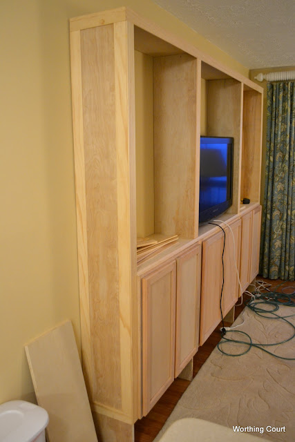 How to build bookcases using kitchen cabinets for the base via Worthing Court blog