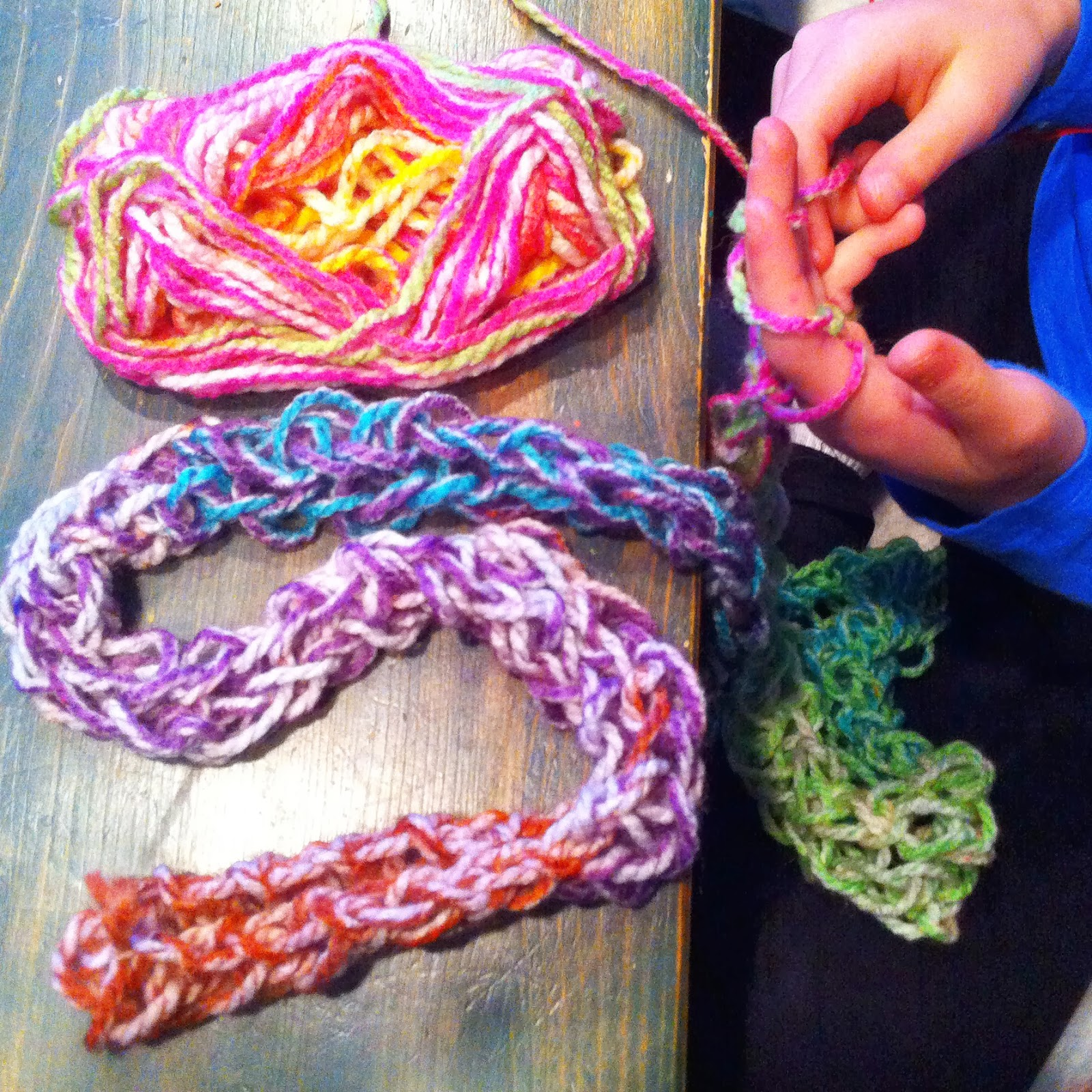 Lil O finger knitting taught at her Montessori school