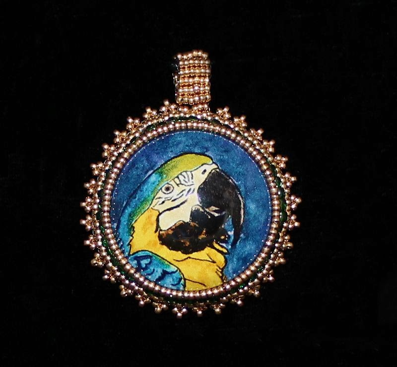 http://www.followmyheartstudio.com/product/macaw-parrot-bead-embroidered-pendant