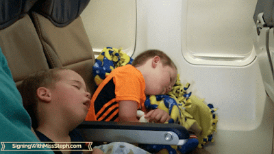 Exhausted boys sleeping on a plane
