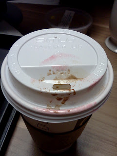 Starbucks disposable cup stained with pink lipstick and chocolate from my morning mocha