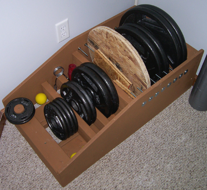 Plate  slots  can store 45 lb. 35 lb. and even spacer plates. & Homemade Strength: Weight Storage Rack