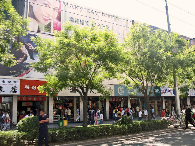 shops on Beijing street with shoppers