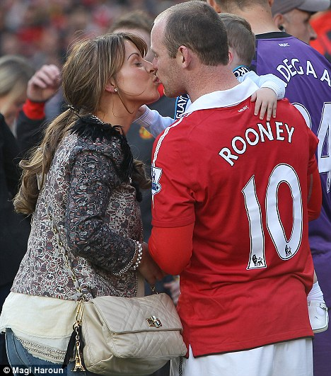 I love Roo! Coleen and Wayne put on unusual public display of affection as they celebrate Manchester United's win