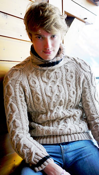 This is a classic aran pullover with a slightly unusual neckline to