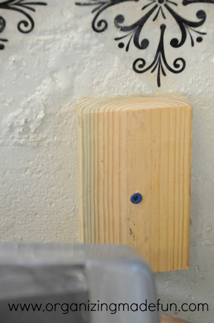Cement screws in wood blocks in the wall | OrganizingMadeFun.com