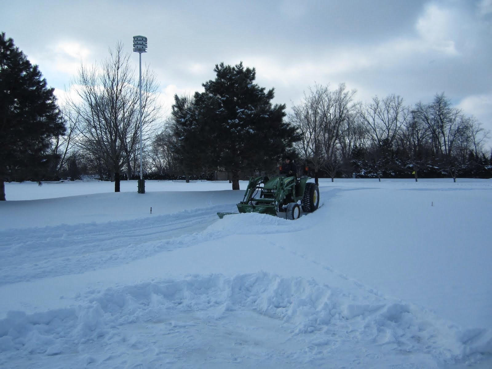 Removing snow from putting greens February 2014