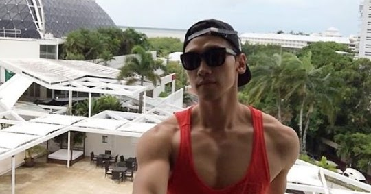 Rain shows off his chiseled muscles while hanging out in