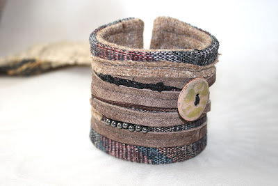 leather cuff with enamel button