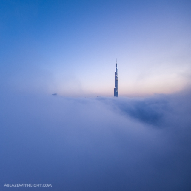 Photo of upper part of the Burj Khalifa above the fog