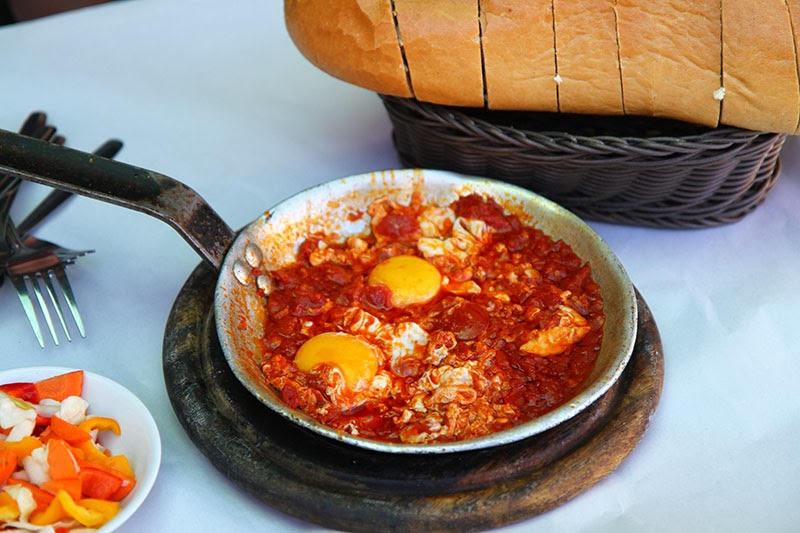 like to top shakshuka off with parsley and crumbled feta.