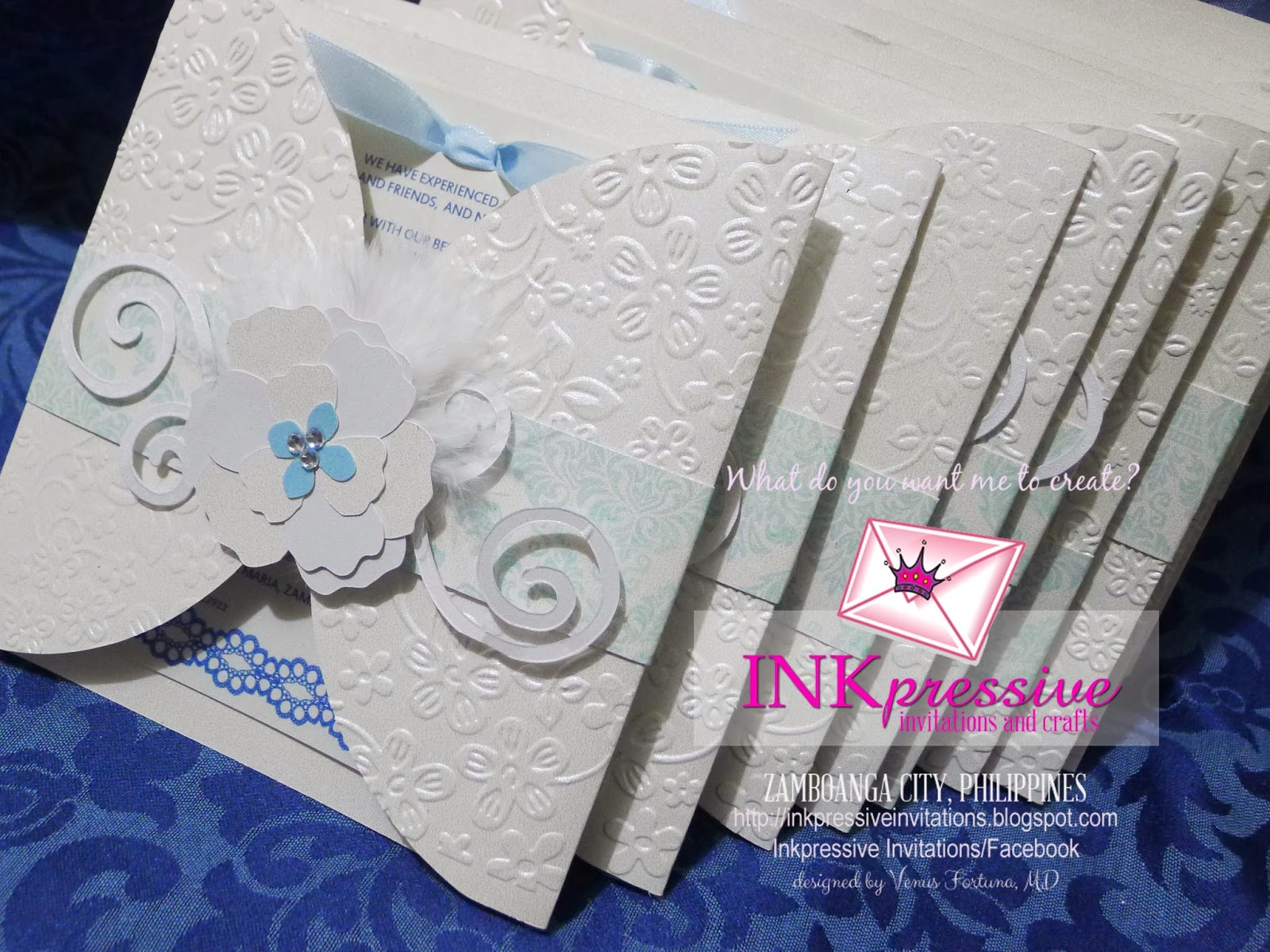 Handmade at its best Wedding Invitation Embossed Feathers