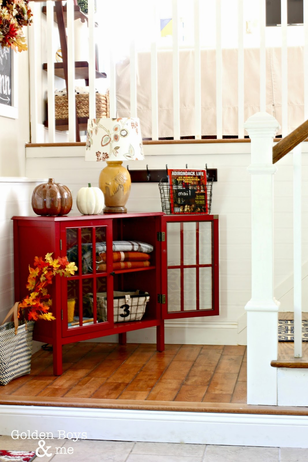 Target Threshold bookshelf with fall plaid blankets and pumpkins, part of autumn entryway-www.goldenboysandme.com