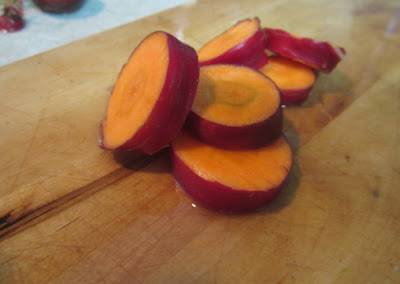 Slices of Cosmic Purple carrots on a cutting board
