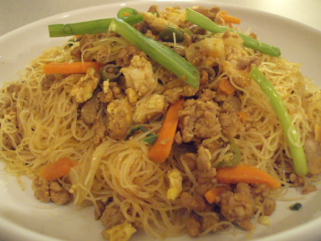 fried bee hoon vermicilli is a dish of thin rice flour noodles fried ...
