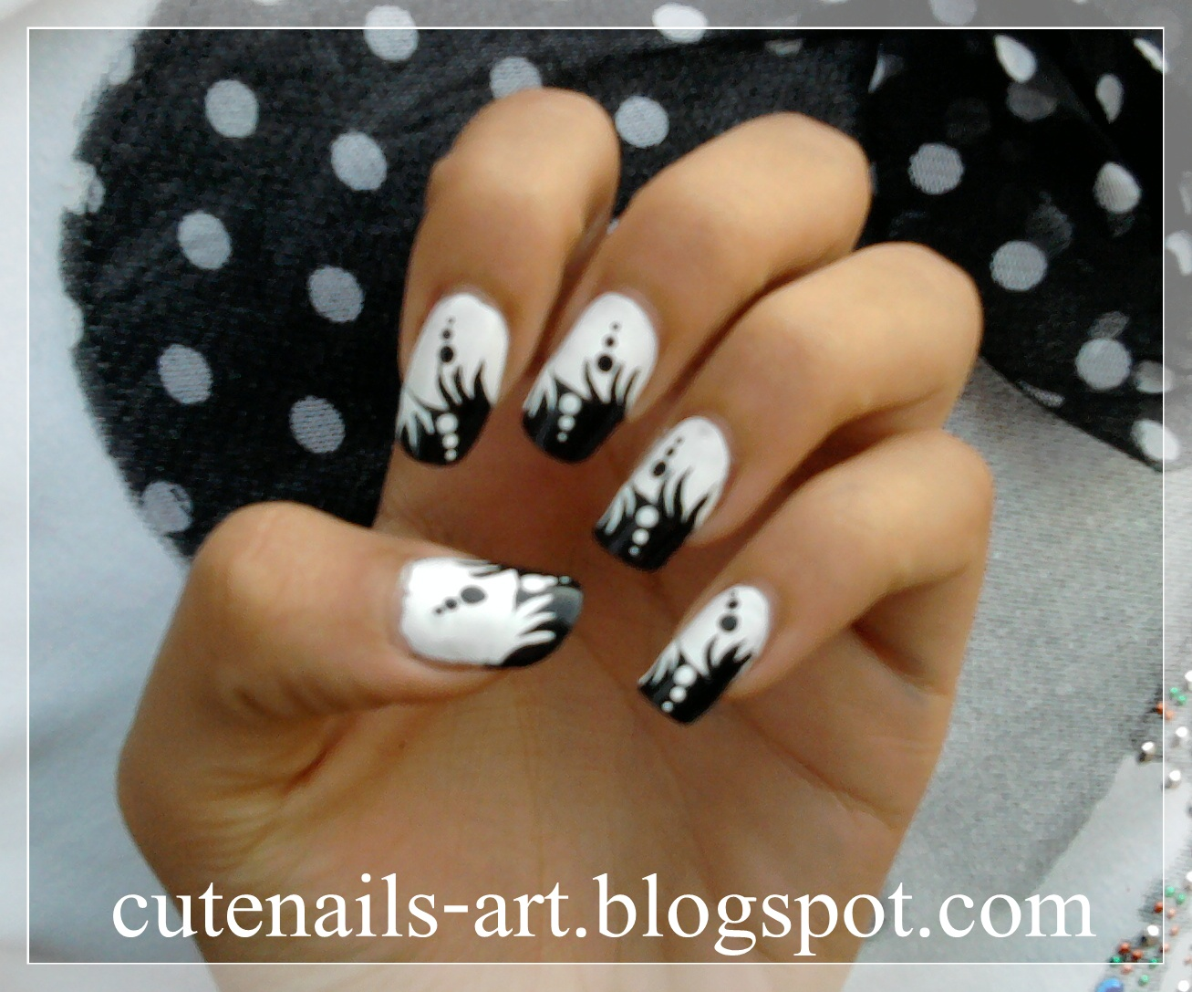 Base coat and using white nail polish paint half of your nails black