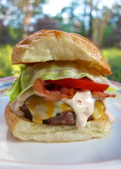 Chipotle Ranch Burgers - hamburger meat, Ranch and pureed chipotles - grill or pan cook the burgers, top with a yummy Chipotle Ranch sauce, bacon, lettuce and tomatoes. SOOOOO good. It has a kick, but we all loved this!